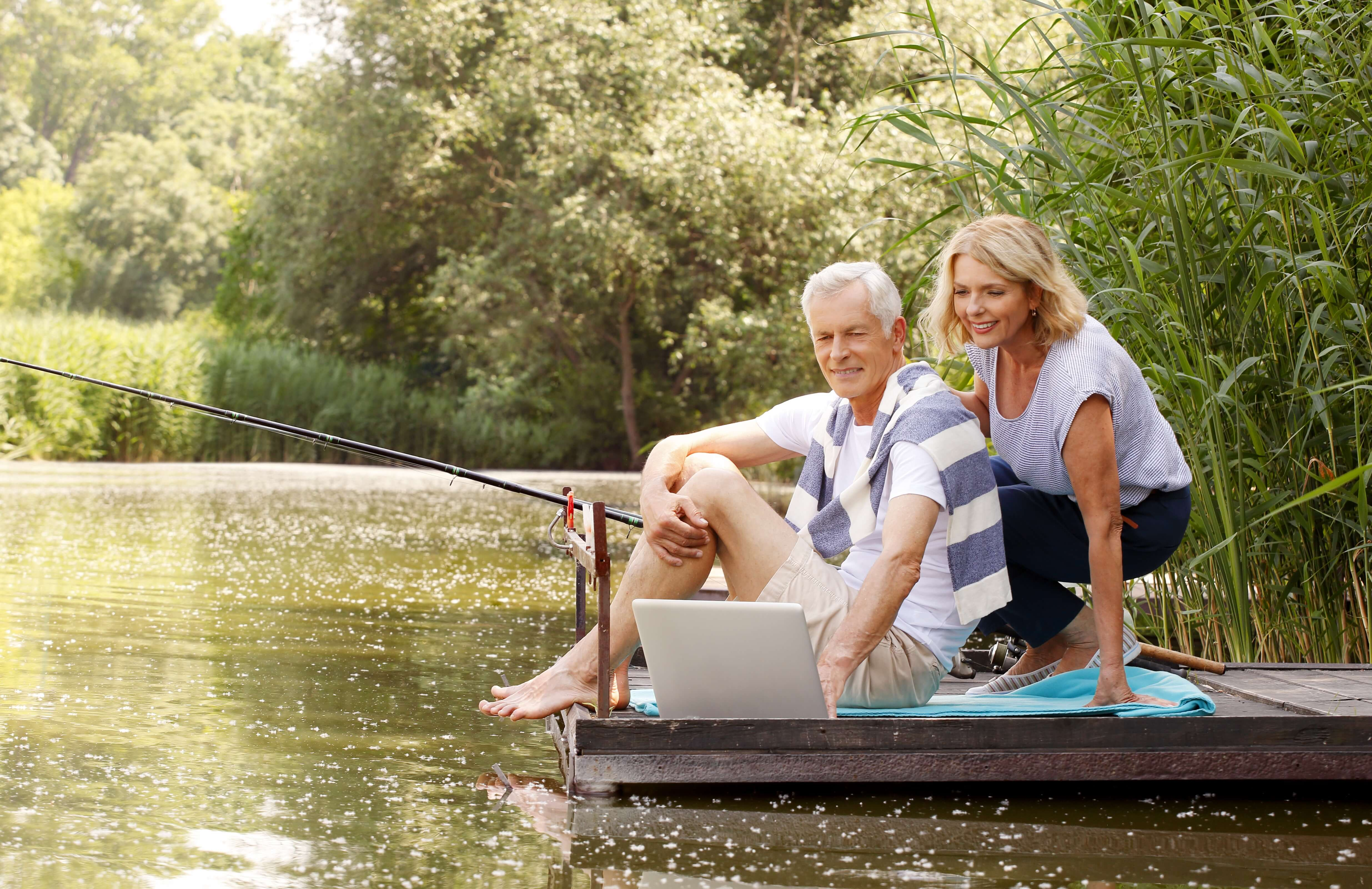 Mature couple fishing on dock
