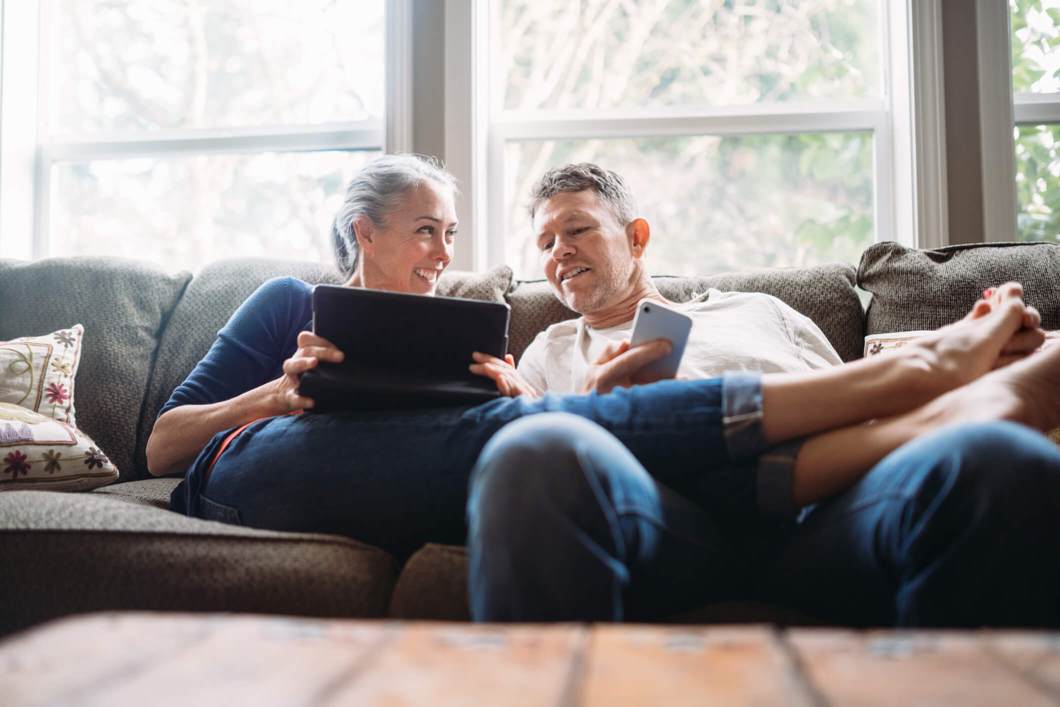 Couple relaxing together on couch